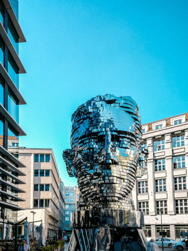 man head bust between buildings