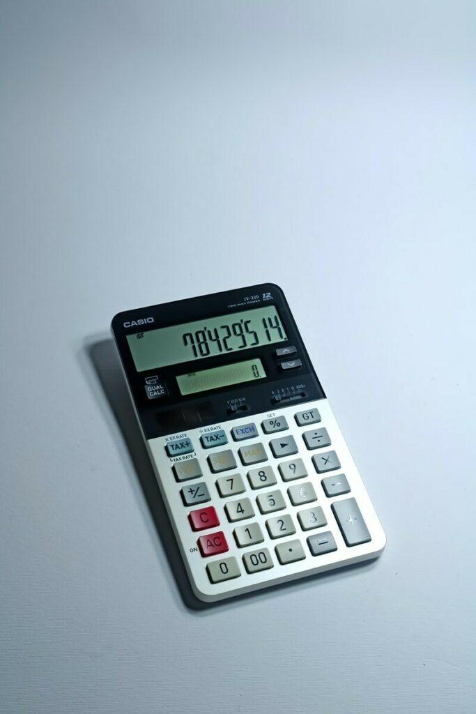 white and black canon calculator