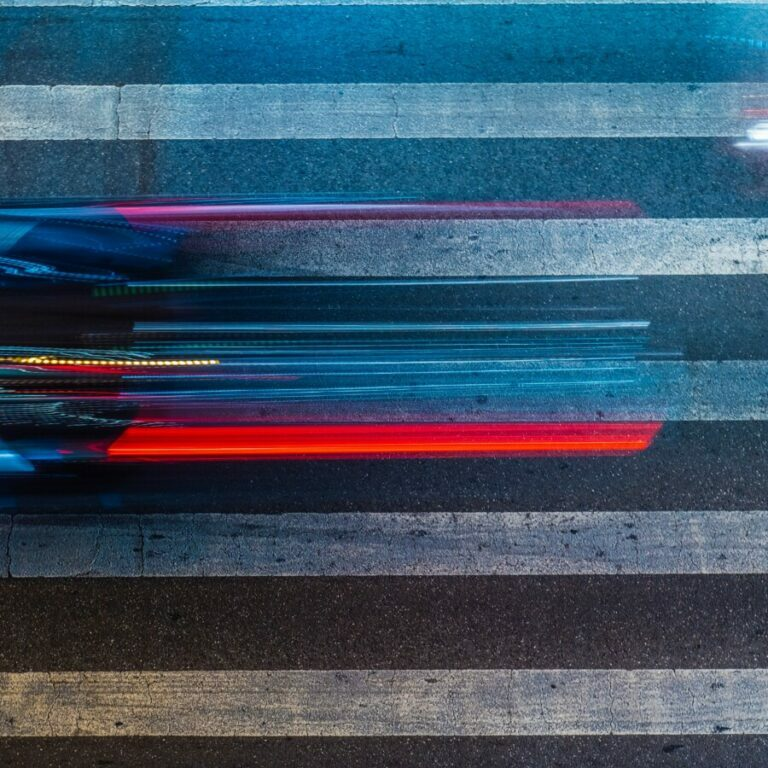blue red and black striped textile